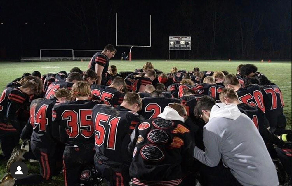 Alex-leading-prayer-after-a-game